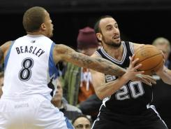 Spurs guard Manu Ginobili, right, broke his hand Monday in the 106-96 loss to the Timberwolves.
