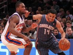 The Bobcats' D.J. Augustin, right, drives past the Knicks' Toney Douglas during the first quarter at Madison Square Garden. Augustin was one of six players in double figures and dished out 10 assists as Charlotte stunned New York.
