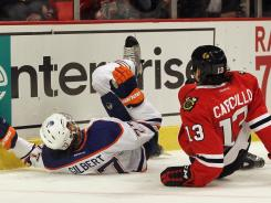 Both Tom Gilbert and Daniel Carcillo were injured when Carcillo shoved the defenseman into the boards.