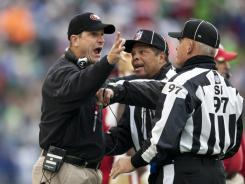 First-year coach Jim Harbaugh, seen here arguing with game officials Dec. 24, guided the 49ers to a 13-3 record, the franchise's best mark since 1997.
