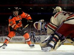 Rangers goalie Henrik Lundqvist  prepares to stop Flyers forward Danny Briere on a penalty shot in the final 20 seconds of the Winter Classic.