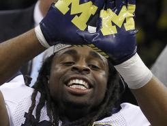 Michigan wide receiver Martavious Odoms celebrates the Wolverines' Sugar Bowl victory over Virginia Tech.