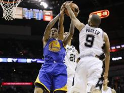 Warriors guard Monta Ellis has his shot blocked by Spurs teammates Tim Duncan and Tony Parker during the second half of their game at the AT&T Center in San Antonio. Ellis had 38 points in the losing effort.