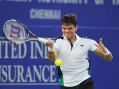 Milos Raonic of Canada raps a forehand Wednesday during his victory against Victor Hanescu or Romania.