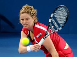 Kim Clijsters of Belgium raps a forehand during her quarterfinal victory Thursday against Iveta Benesova of the Czech Republic.