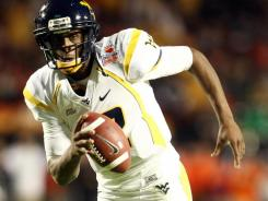 West Virginia quarterback Geno Smith eyes the end zone during his 7-yard scoring run in the second quarter.
