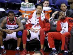 A dejected Washington Wizards bench Sunday contemplates the 0-8 start, worst in club history.