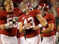 Alabama kicker Cade Foster celebrates with teammates after making a field goal against LSU.