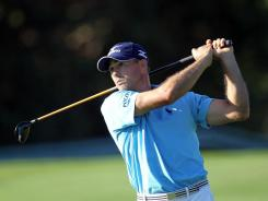 Jonathan Byrd plays a shot on the 15th hole during the first round of the Hyundai Tournament of Champions  in Kapalua, Hawaii. Byrd shot a 6-under-par 67 to take the lead after the first round.
