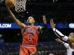 Derrick Rose had 21 points, 10 assists and eight rebounds as Chicago handed Orlando its first home loss of the season.