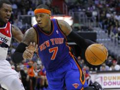 Carmelo Anthony (7) scored 37 points, including the go-ahead 3-pointer that gave the Knicks their seventh consecutive win over the Wizards.