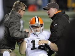 Trainers tend to Cleveland Browns quarterback Colt McCoy after he was hit by Pittsburgh Steelers outside linebacker James Harrison on Dec. 8, 2011.