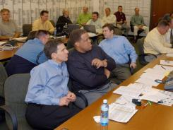 This photo provided by the Green Bay Packers shows the draft room during the late first round of the 2006 NFL Draft. New Raiders general manager Mike McKenzie is seated at center.