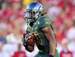 Running back LaMichael James is leaving early for the NFL after setting Oregon career records for rushing yards and touchdowns.