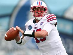 Quarterback J.J. McDermott threw for one touchdown and ran for another to help SMU cruise past Pittsburgh at the Compass Bowl.