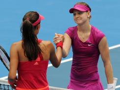Lucie Safarova, right, shakes hands with Ana Ivanovic following their first-round match at the Sydney International. Safarova won 7-6 (7-5), 6-2.