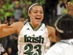 Notre Dame guard Kayla celebrates the Fighting Irish's overtime win against Connecticut in South Bend, Ind.