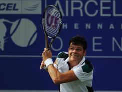 Milos Raonic follows through on a backhand during his victory Saturday against Nicolas Almagro of Spain.