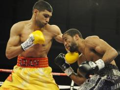Amir Khan, left, of England, lost to Lamont Peterson during a Dec. 10 fight in Washington. The vice president of the WBA called for a rematch of the title fight.