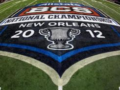 BCS officials will meet on Tuesday after the championship to discuss changes to the current bowl system.