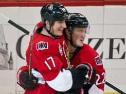 Filip Kuba (17) and Erik Condra (22) celebrate Kuda's go-ahead goal with just over a minute left that gave Ottawa a come-from-behind win over the Flyers.