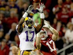 LSU cornerback Morris Claiborne, left, intercepts a pass over Alabama tight end Brad Smelley on Nov. 5 during the teams' regular-season meeting won by the Tigers 9-6 in overtime.
