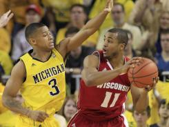 Michigan freshman Trey Burke also played strong defense on Wisconsin leader Jordan Taylor.