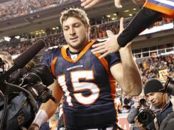 In his first career playoff game, Tim Tebow threw two TDs and ran for another score in the Broncos' stunning overtime win.