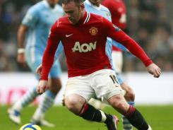 Wayne Rooney's brace carried United over City during their Manchester derby in the FA Cup third round at the Etihad Stadium.