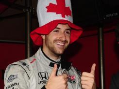James Hinchcliffe dons a maple-leaf cap to pay homage to his Canadian heritage before last year's Indianapolis 500. The reigning rookie of the year is taking over for Danica Patrick at Andretti Autosport.