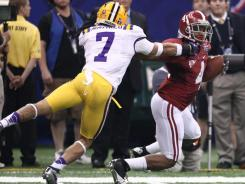 Alabama Crimson Tide wide receiver Marquis Maze is brought down by LSU cornerback Tyrann Mathieu  after a long punt return in the first quarter.