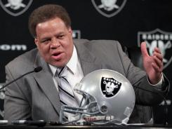 Reggie McKenzie answers questions during his introduction as  general manager of the Oakland Raiders.