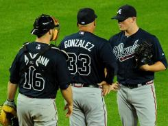 Braves manager Fredi Gonzalez and catcher Brian McCann talk with closer Craig Kimbrel, right, who had 46 saves last season and was voted NL rookie of the year.