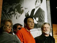 In a 2005 photo, Muhammad Ali is accompanied by his wife Lonnie and singer Kris Kristofferson as he tours the Muhammad Ali Center in Louisville