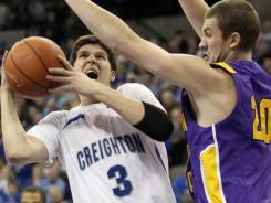 Creighton forward Doug McDermott (3) is blocked by Northern Iowa forward Jake Koch (20) during the first half at the CenturyLink Center in Omaha.