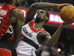 Wizards forward Chris Singleton attempts a layup defended by Raptors forward Amir Johnson (15) during the first half at the Verizon Center.