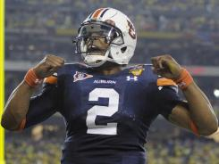 Auburn's Cam Newton reacts after a touchdown during the first half of the BCS National Championship NCAA college football game against Oregon on Monday, Jan. 10, 2011, in Glendale, Ariz.