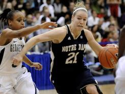 Notre Dame guard Natalie Novosel (21) drives to the basket past Georgetown guard Rudylee Wright during second half in Washington.