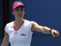 Germany's Andrea Petkovic, seen here playing Anastasia Pavlyuchenkova  in the first round of the Sydney International, lost her second round match and has pulled out of the Australian Open. She would have been seeded 10th.