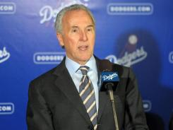 Frank McCourt, seen here at press conference to announce the signing of outfielder Matt Kemp in late 2011, reached a deal with Major League Baseball in November to sell the Dodgers by April 30.