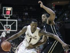 Florida State's Xavier Gibson drives against the defense of Central Florida's Dwight McCombs in the first half of an NCAA college basketball game which Florida State won 73-50 on Monday, Nov. 14, 2011.