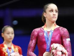 Jordyn Wieber of the USA, right, and Sui Lu of China stand on the podium after the final of the women's balance beam at the  world championships in Tokyo on Oct. 16, 2011.