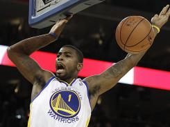 Golden State's Dorell Wright dunks against Miami during the second half of the Warriors' overtime win.
