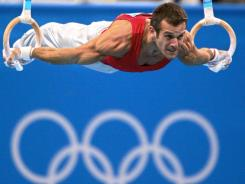 In this 2004 file photo, Bulgaria's Jordan Jovtchev performs during the men's rings final at the Olympic Indoor Hall during the Athens Games.