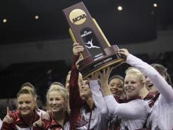 The Alabama women's gymnastics team, celebrating last year's national title, opens this season Friday against perennial power Georgia.