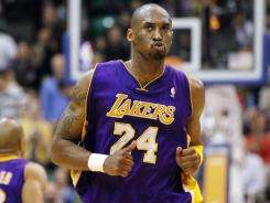 Lakers guard Kobe Bryant (24) reacts after hitting a shot during the second half in Salt Lake City on Wednesday.
