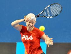 Defending Australian Open Champion Kim Clijsters gets in some practice ahead of the season's first major.