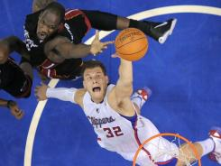 Clippers forward Blake Griffin (32) goes for a rebound against Miami center Joel Anthony during the first half in Los Angeles.