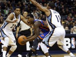 Memphis teammates Rudy Gay, left, and Mike Conley converge on New York guard Iman Shumpert during the first half of their game. Gay had a game-high 26 points as the Grizzlies cruised past the Knicks.