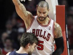 Chicago Bulls forward Carlos Boozer had 17 points and 11 rebounds in the 104-64 blowout on New Year's Day of center Marc Gasol and his Memphis Grizzlies.